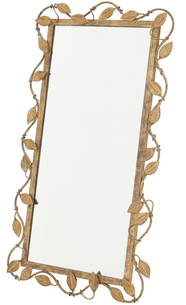 This mid-20th century rectangular brass mirror features beautiful leaf detailing around its edges.  Since Schumacher was founded in 1889, our family-owned company has been synonymous with style, taste, and innovation. A passion for luxury and an