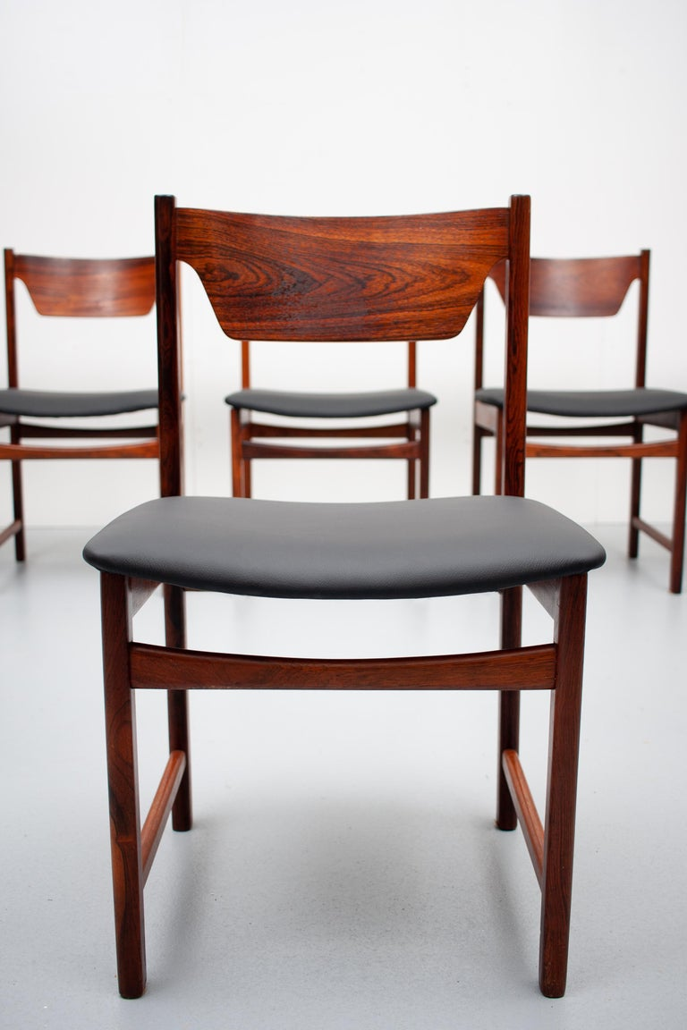 6 Beautiful solid wood dining chairs . All the seats are new reupholsters in a good quality  Black leather . Very nice color  . Great looking chairs . Scandinavian 1960s
