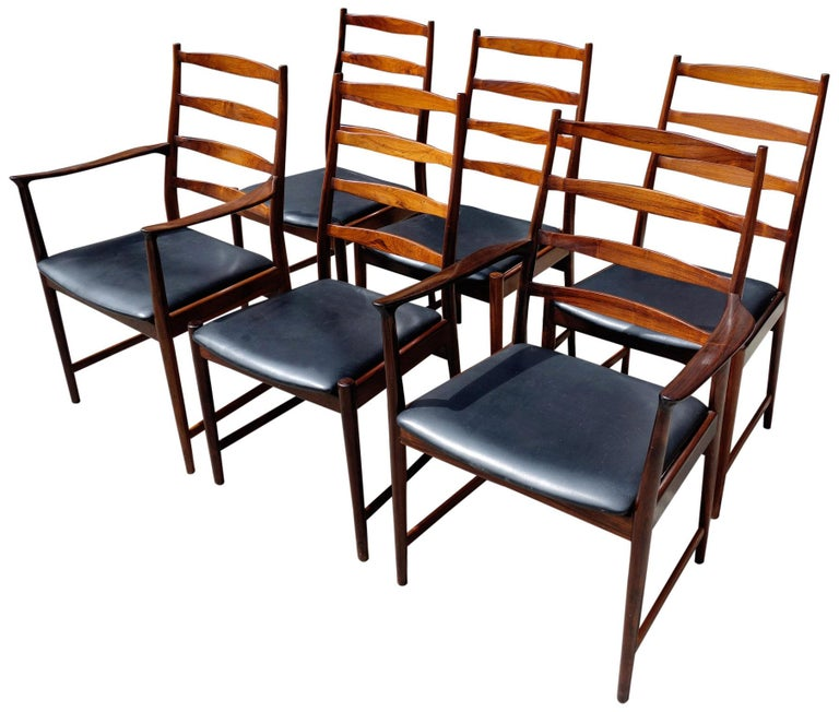 Wonderful set of 6 (six) rosewood dining chairs featuring two armchairs and 4 (four) side chairs. Very comfortable and of high quality. Vamo Sonderbor of Denmark employed designers such as Johannes Andersen, Arne Vodder, and Torbjorn Afdal.