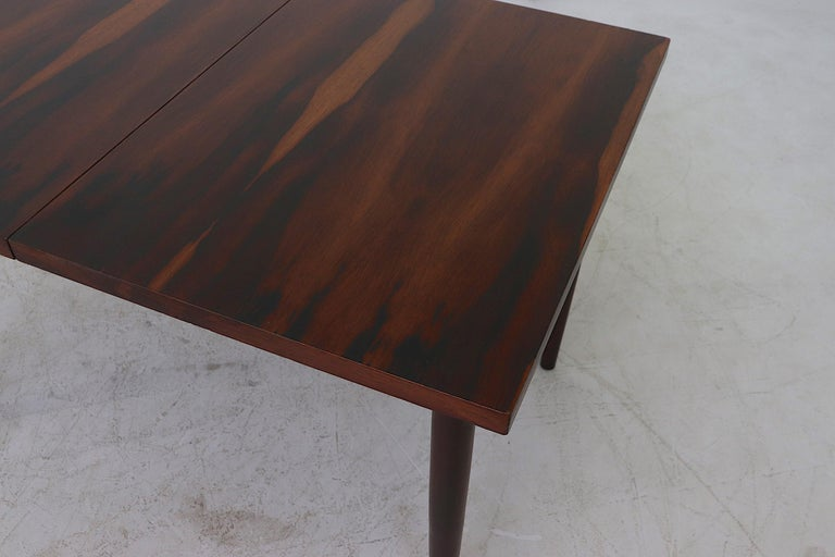 Midcentury Rosewood Dining Table with Hidden Leaf For Sale 4