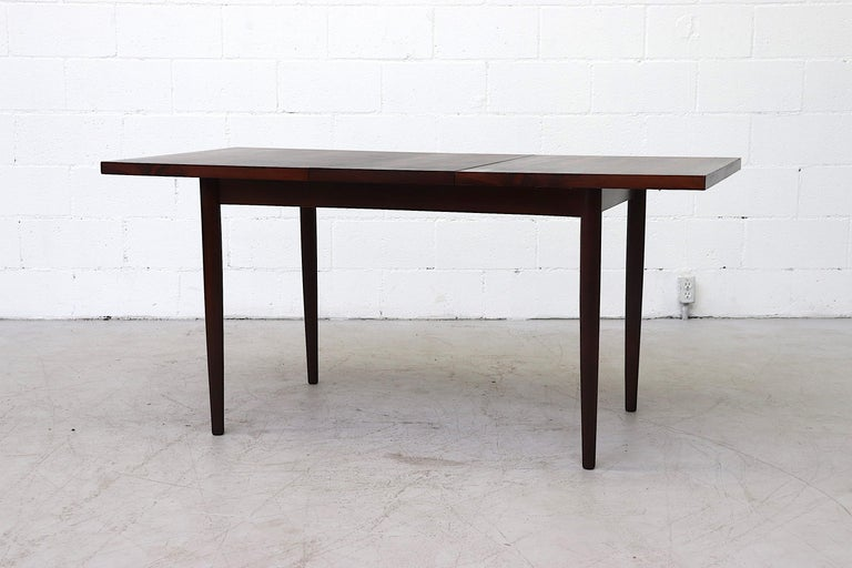 Mid-Century Modern Midcentury Rosewood Dining Table with Hidden Leaf For Sale