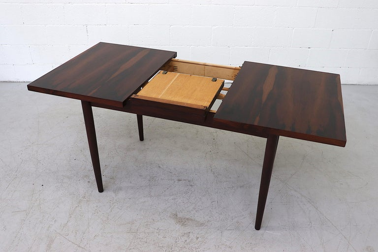 Dutch Midcentury Rosewood Dining Table with Hidden Leaf For Sale