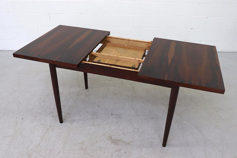 Midcentury Rosewood Dining Table with Hidden Leaf In Good Condition For Sale In Los Angeles, CA