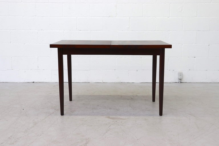 Mid-20th Century Midcentury Rosewood Dining Table with Hidden Leaf For Sale