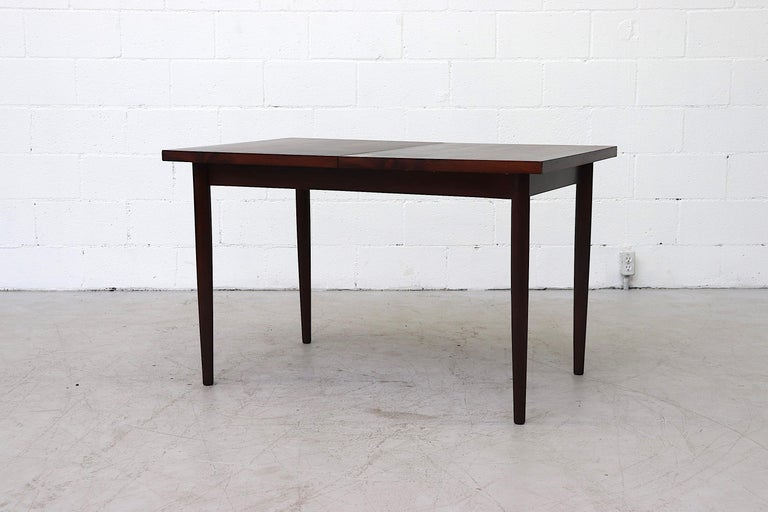 Midcentury Rosewood Dining Table with Hidden Leaf For Sale 1