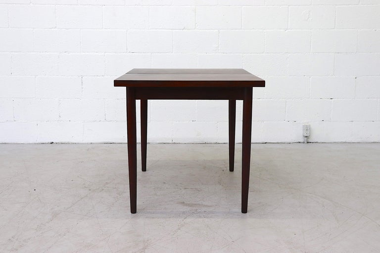 Midcentury Rosewood Dining Table with Hidden Leaf For Sale 2