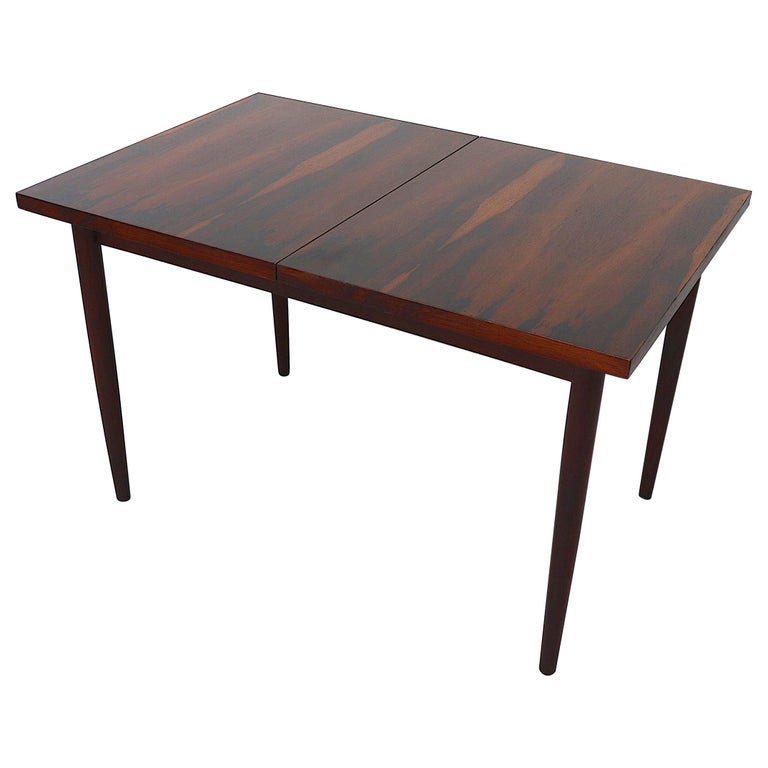 Midcentury Rosewood Dining Table with Hidden Leaf For Sale