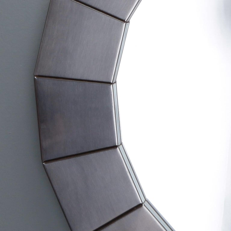 """Round mirror with wide, sectioned frame of silver tone brushed aluminum, circa 1970s. Actual Mirror Size: 18.75"""" diameter. Unknown maker. Found in Belgium."""