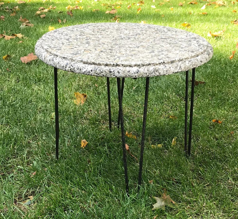 Cool small mid century stone top round side table with wrought iron hairpin legs, 1950s. Patio or poolside side table, can also be used as a small coffee table. One of the hairpin legs is slightly bent, hardly noticeable, please see photo.