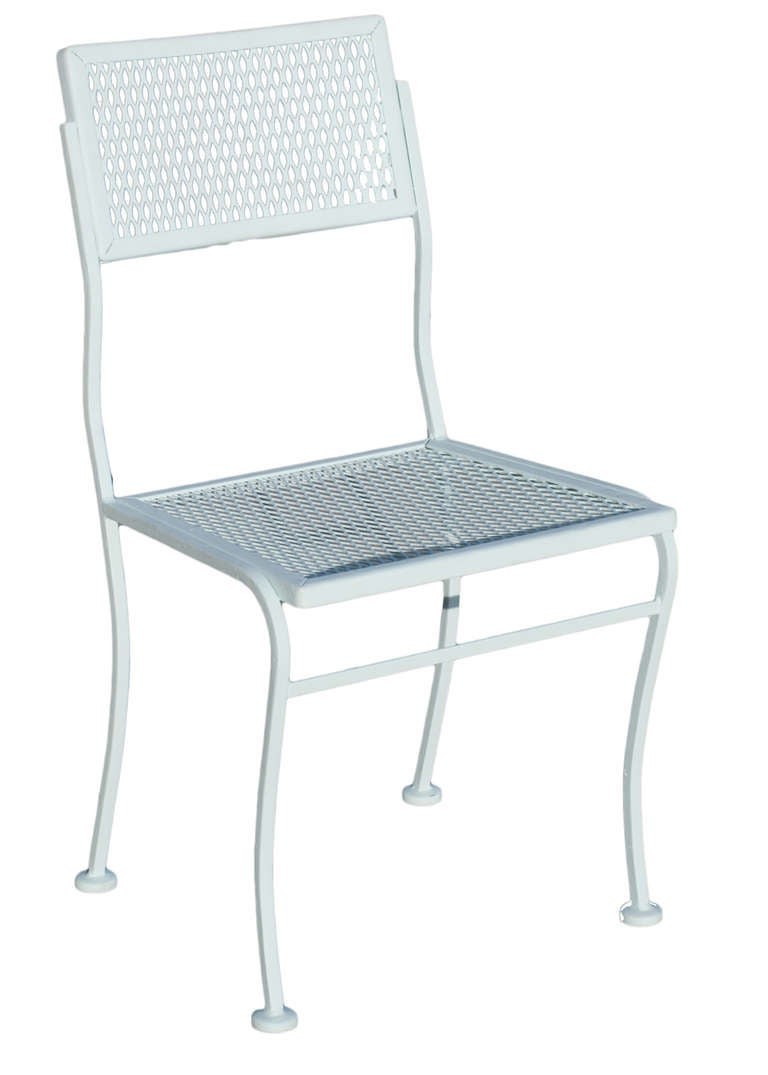 Outdoor steel mesh table and chairs set with one table and four chairs by the Woodard Company. The set has been repainted in flat teal; another color can be used upon request. Powder coating available upon request.