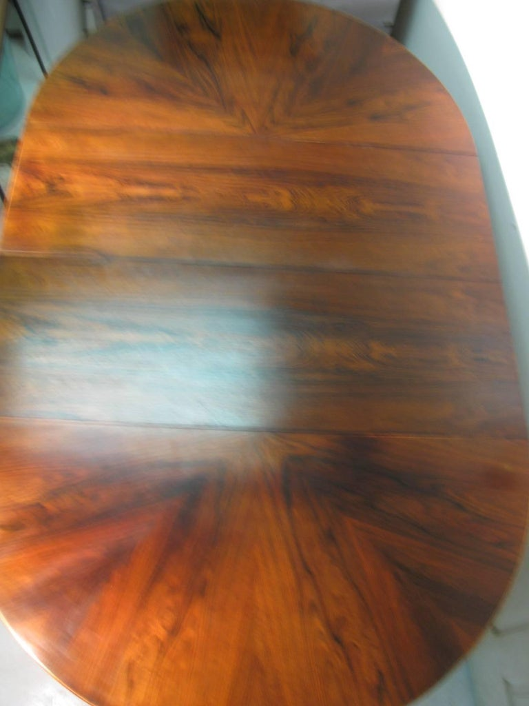 Oiled Midcentury Scandanavian Modern Rosewood Dining Room Table with Two Leaves For Sale