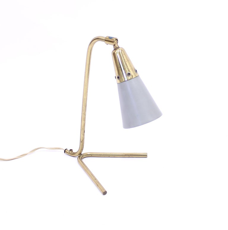 Midcentury Scandinavian brass table lamp with a grey shade. Most likely Swedish but unknown manufacturer. Good vintage condition with light ware consistent with age and use.