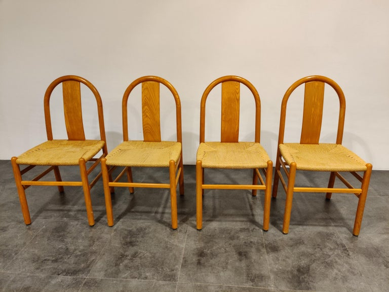 Set of 4 Scandinavian dining chairs with paper cord seats.  Beautiful, quality dining chairs with eye for detail and craftsmanship.  Original seats in good condition.  Very charming set of chairs  Designer unknown, probably Danish  1960s, Denmark