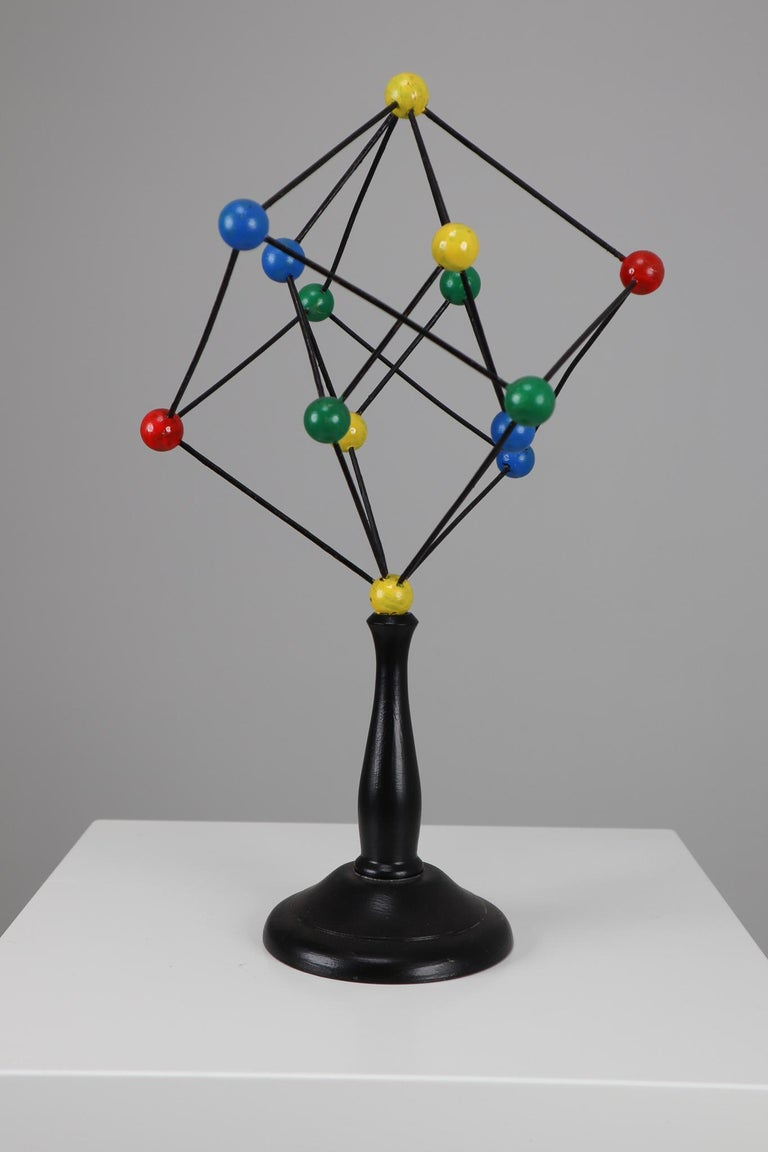 Mid-century scientific crystal model from Czechoslovakia from the 1950s. Made for educational reasons, used for classroom demonstration and study. In good condition with signs of age and patina.