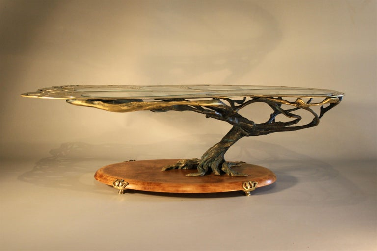 A unique bronze coffee table in the shape of a bonsai tree.