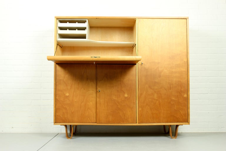 Birch series cabinet by Cees Braakman for Pastoe, type CB-01. Working desk behind the flap door. Flap door has a Formica top on the inside with room for storage of stationary, with two smaller drawers. Typical Braakman 'dust free' drawers and bent