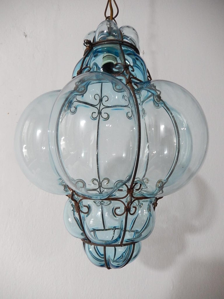 Housing one light. Rare aqua Murano blown glass. Great craftsmanship. Re-wired and ready to hang. Free priority shipping from Italy. Adding another 20 inches (can be shortened) of original chain and canopy.