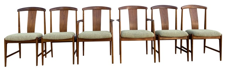 Beautiful midcentury set of 6 teak dining chairs by Folke Ohlsson for DUX. Very beautiful designed and crafted set of dining chairs with elegant curved backs. The set has all new wool woven upholstery very neutral tones hint of green and sand/tan