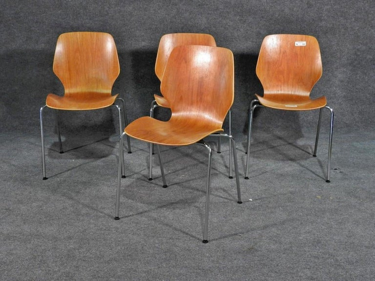 Bentwood seats on polished chrome bases. Strong and comfortable. (Please confirm item location - NY or NJ - with dealer).