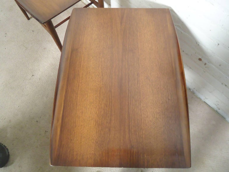 Nicely designed tables with walnut grain, sculpted legs, shelf and turned edges. Danish modern style that is great for home or office.