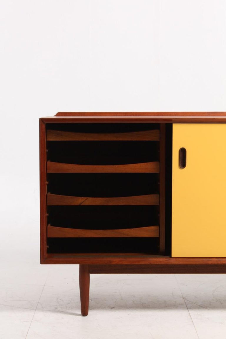 Scandinavian Modern Midcentury Sideboard in Teak with Colored Panels by Arne Vodder