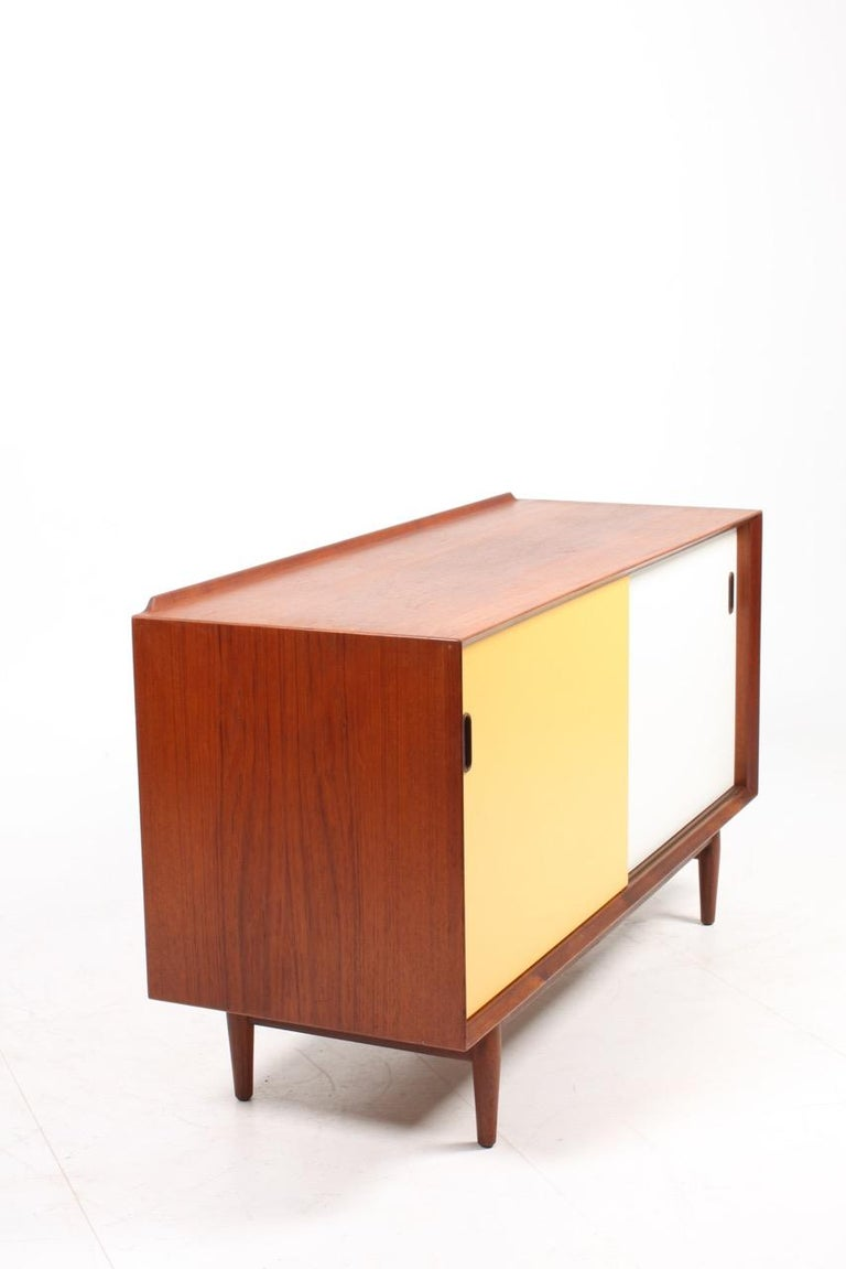 Mid-20th Century Midcentury Sideboard in Teak with Colored Panels by Arne Vodder