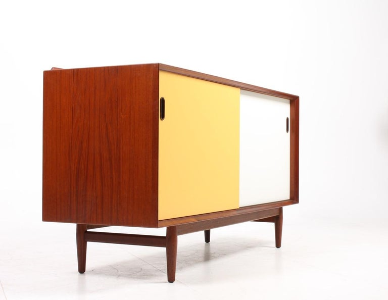 Midcentury Sideboard in Teak with Colored Panels by Arne Vodder 1