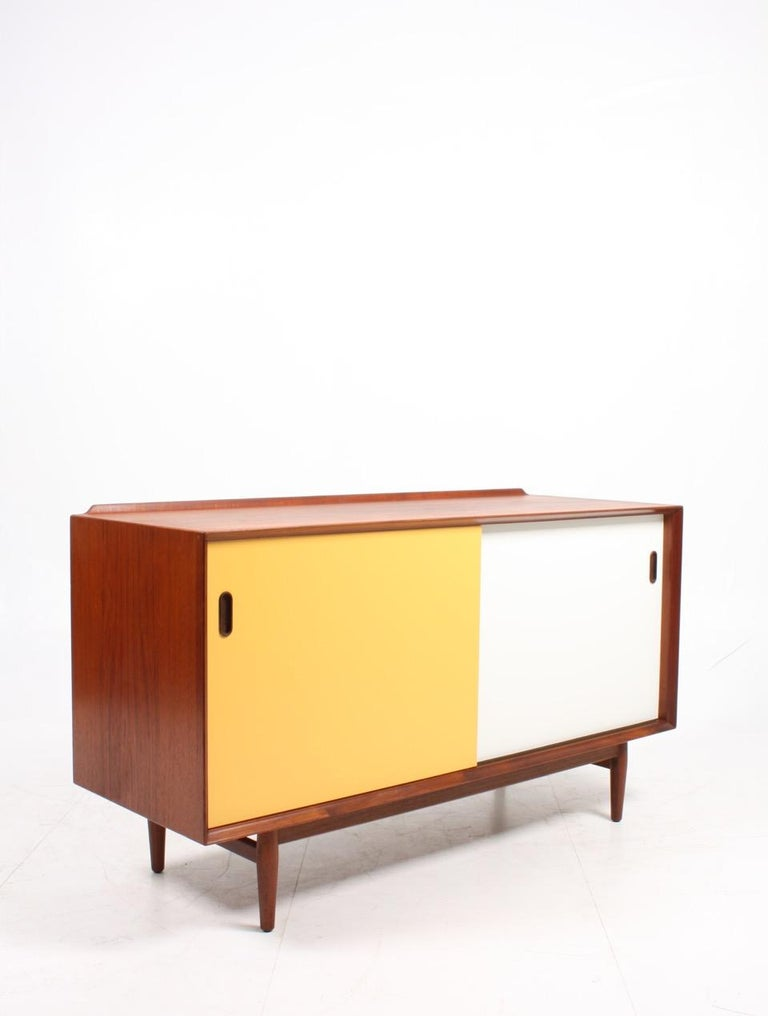 Midcentury Sideboard in Teak with Colored Panels by Arne Vodder 2