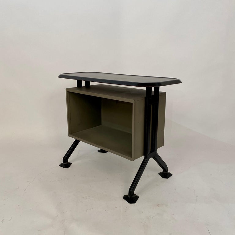 This midcentury sideboard or office cabinet was designed by B.B.P.R. for Olivetti in Italy circa 1963. It is from the Arco Series. It is made out of lacquered metal, plastic and pressed pear wood. A unique piece which is a great eye-catcher for