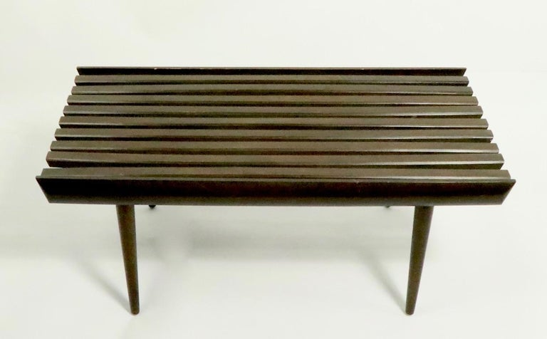 Iconic mid century  slat bench, coffee table, on diminutive scale. This example is in very good original condition, showing only light cosmetic wear, and slight variations in shape of slats, normal and consistent with age.
