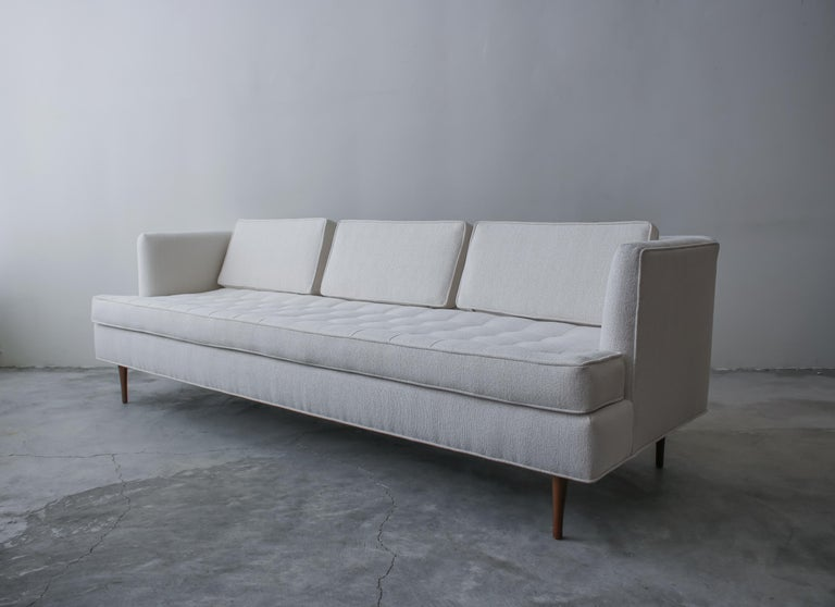 Midcentury sofa designed by Edward Wormley for Dunbar Furniture. A Classic, beautiful sofa. Lines get no cleaner than this. The biscuit tufted seat and double tapper legs really add to the great detail.