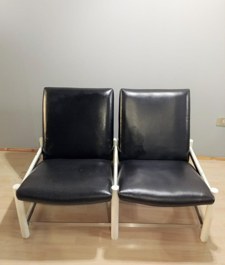 Dal Vera 2-seat design sofa with wooden and metal structure with black leather seat, from the 1950s, Italy.