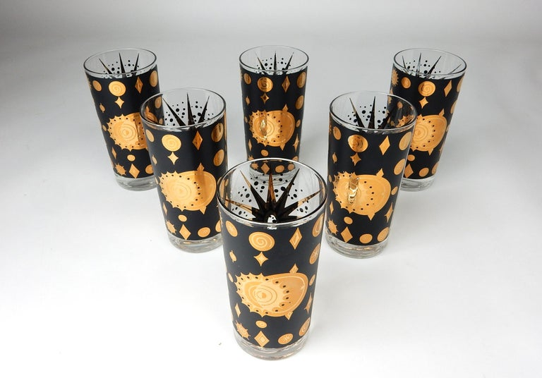 Spectacular set of hi-ball bar glasses by Fred Press. Big golden star on one side and celestial gold planets of the other. Set shows light use only.
