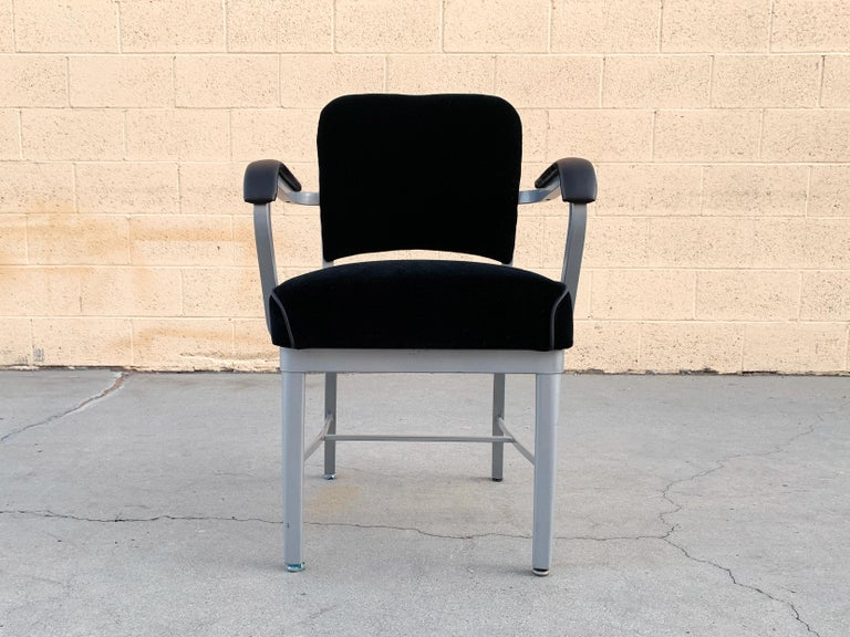 Classic midcentury steel tanker armchair refinished in metallic silver powder-coated frame (Bengal Silver) and upholstered in black velvet with black leather arms. Most likely attributed to Steelcase, circa 1950s.   Dimensions: 21