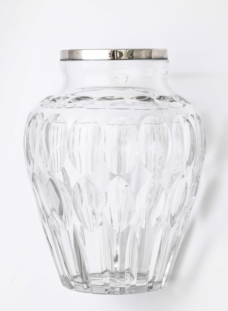 Mid-Century, sterling silver-mounted, cut crystal vase, Germany, circa 1950s, Argentium Co. - makers. Measures 7 inches high x 5 1/2 inches diameter at widest point. Incised star on underside of vase. Thumbprint pattern. Dark spots in photos are