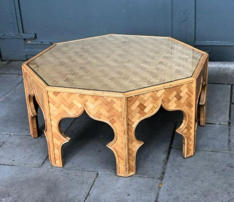 Mid century stick rattan & bamboo coffee table, Italian, 1970s  Magnificent mid-century octagonal stick rattan coffee table.  Fantastic Moorish inspired coffee table, beautiful detailed stick rattan framework, sides and top covered in bamboo