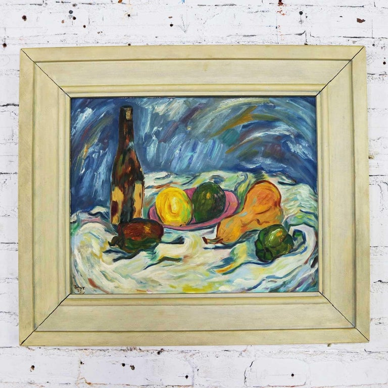 Beautiful midcentury still life with fruit and wine bottle signed Tonar 1959. It is on canvas panel and in wonderful vintage condition overall. However, the original frame could use rehabbing. We leave that up to the buyer to leave as is, restore,