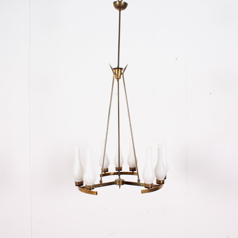 Elegant gilt brass chandelier with nine opal glass lampshades, attributed to Stilnovo, 1950s, Italy. Wear according to age and use.