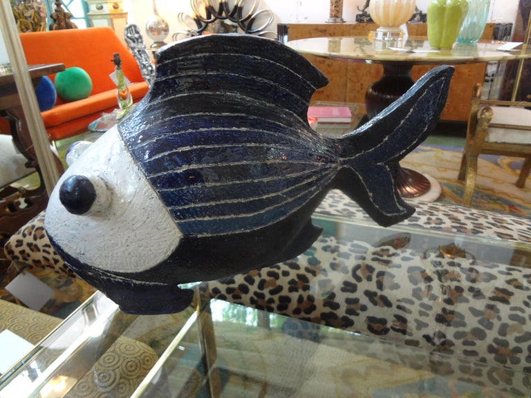 0Beautifully executed vintage studio art pottery fish sculpture. This large Hollywood Regency fish sculpture is executed in two beautiful shades of blue and white.
