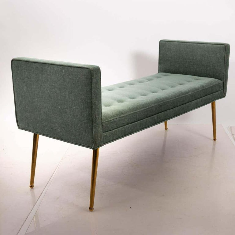 Two arm custom made midcentury style bench with brass legs, buttons and seaming. This piece is showroom sample and available for immediate purchase. Can also be custom ordered in any size with or without arms. COM. Legs can be plated as needed or