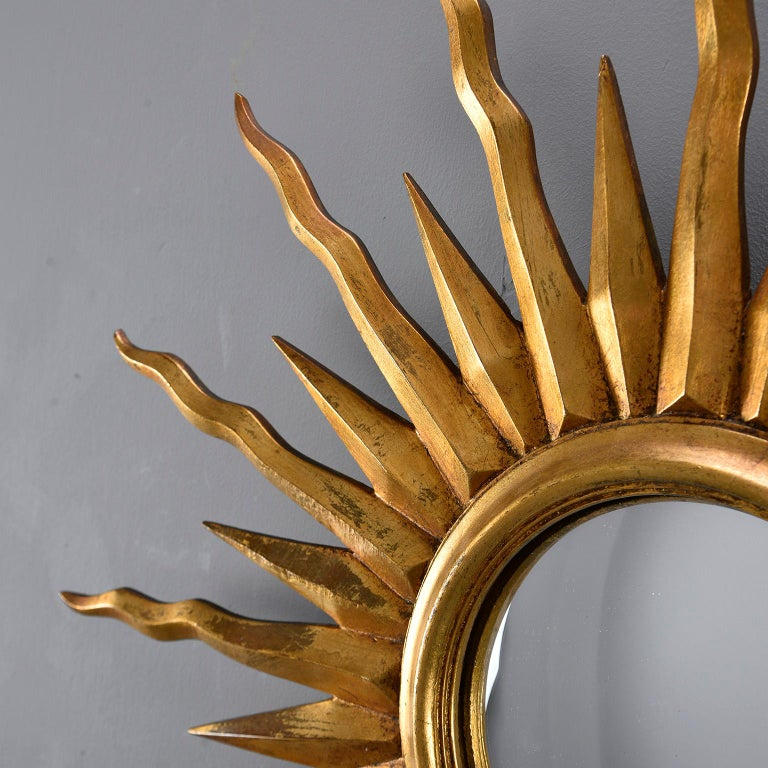 Giltwood sunburst mirror found in Italy, circa 1960s. Alternating short and long rays. Marks on back say Huis Herbert.