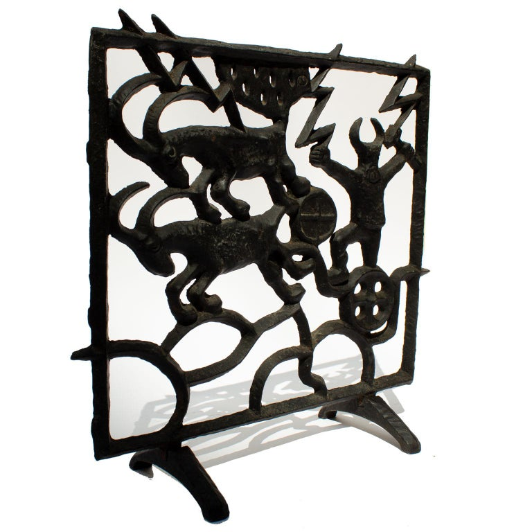 Midcentury Swedish fireplace screen by Olle Hermansson for Husqvarna. A cast iron fireplace with a theme from the nordic mythology. We can see Thor (Tor) and his running goats and the hammer Mjöllnir. Thor was the god of the storm, and thunder. The