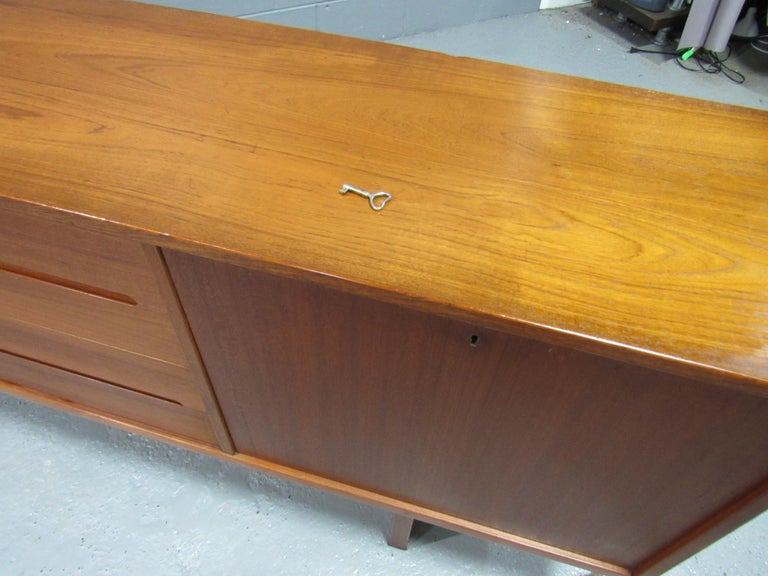 Midcentury Swedish extra long sideboard credenza by Nils Jonsson for Hugo Troeds. Extremely well crafted and excellent vintage condition.