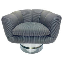 Midcentury Swivel Club Chair on Polished Steel and Brass Base