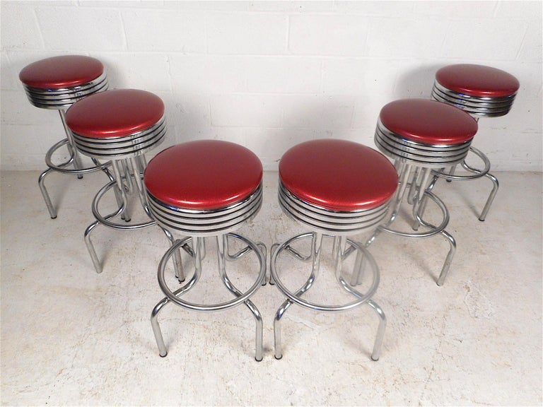 Stylish set of 6 midcentury stools. Sturdy chrome frame with footrests and swiveling seats. Classic longneck design. Sure to make an interesting addition to any modern interior. Please confirm item location with dealer (NJ or NY).