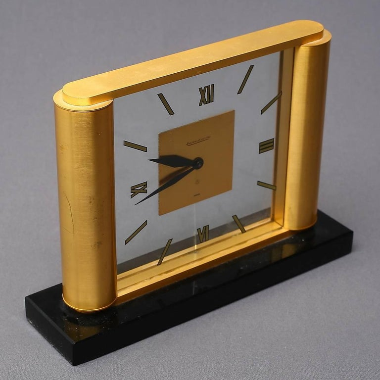 Brass and glass construction with eight days movement. Made by Jaeger-LeCoultre in Switzerland in the 1960s.
