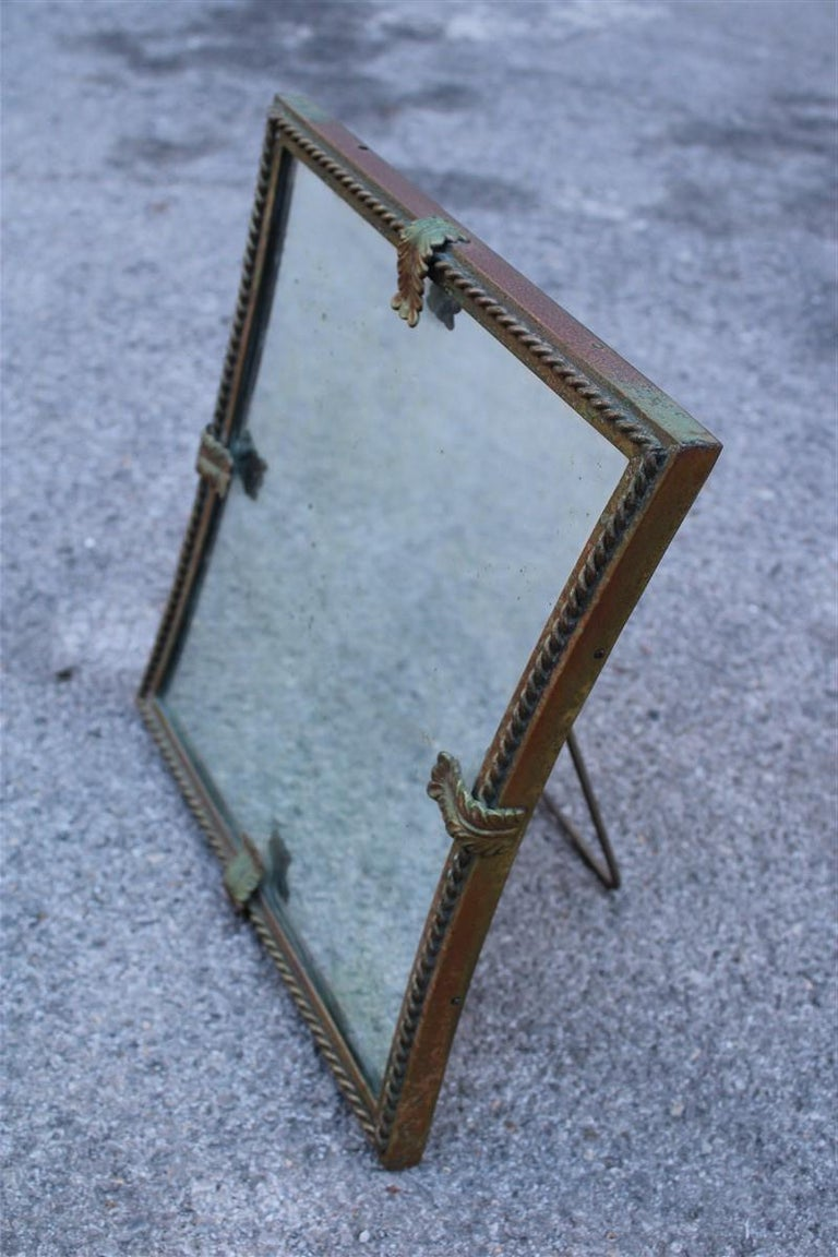 Midcentury table mirror brass gold Italian design 1950s leaves. The mirror is original with its stains, if you wish we can change it, included in the price.