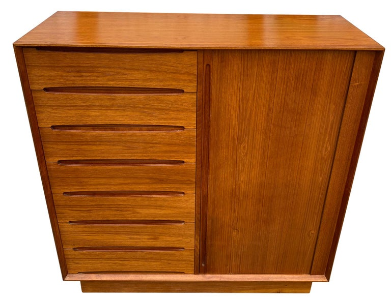 Midcentury tall Dyrlund teak dresser credenza 7-drawer on left. Clean inside and out - labeled - Made in Denmark. Good vintage condition. Has right sliding door with 8 drawers.