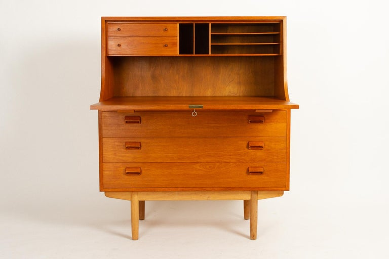 Midcentury teak and oak Secretaire by Børge Mogensen for Søborg Møbelfabrik, 1960s. Large teak secretary with legs in solid oak. Drop down front. Large desk area. Two small drawers and five open compartments above the desk area. Underneath is three