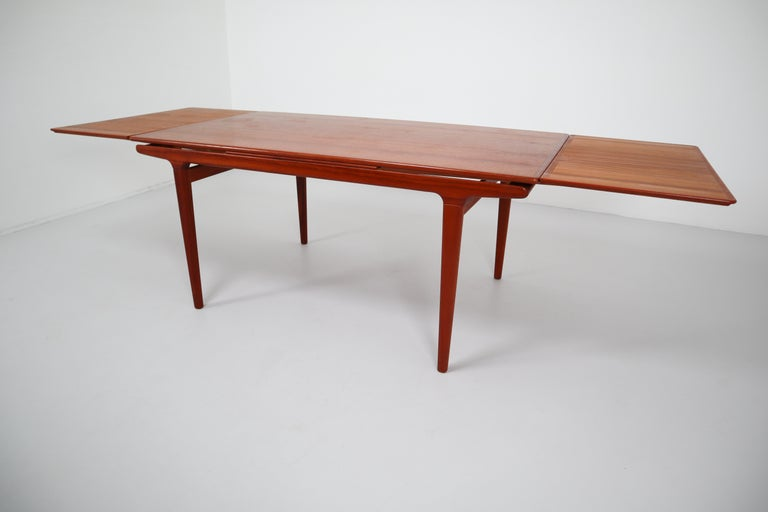 Scandinavian Modern Midcentury Teak Dining Table with Extensions by Niels Møller, Denmark, 1950s For Sale